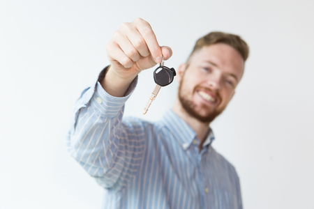 Young Man Holding Key to New Car