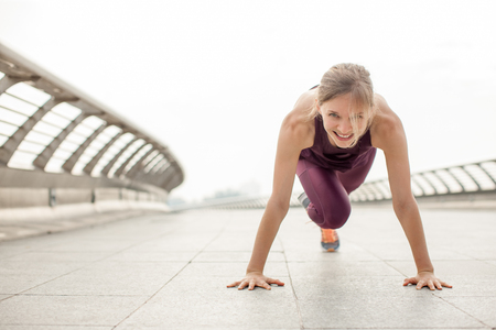 Girl Doing Mountain Climber Exercise on Bridge Stock fotó