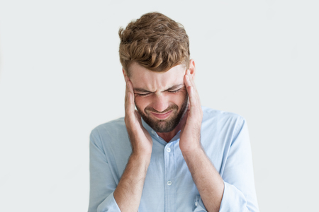Disordered Young Man Suffering from Headache Stock Photo