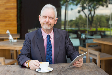 Arrogant Business Man with Tablet and Coffee