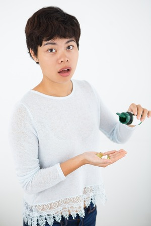 Shocked Asian woman does not have necessary pills Stock Photo
