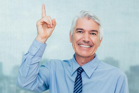 Happy successful senior businessman having idea