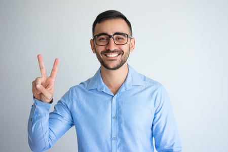 Happy Handsome Man Showing Victory Sign