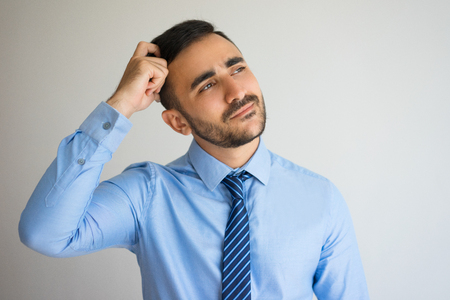 Pensive Businessman Thinking over New Offer