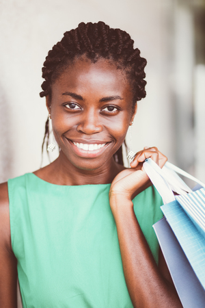 Portrait of happy young woman with shopping bags Stock Photo