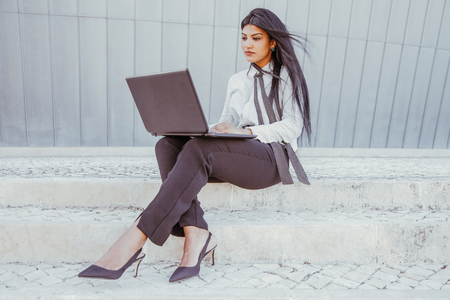 Concentrated businesswoman typing on laptop