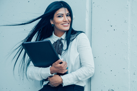 Happy young female entrepreneur with laptop Banco de Imagens