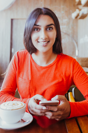 Positive young woman resting in coffee shop