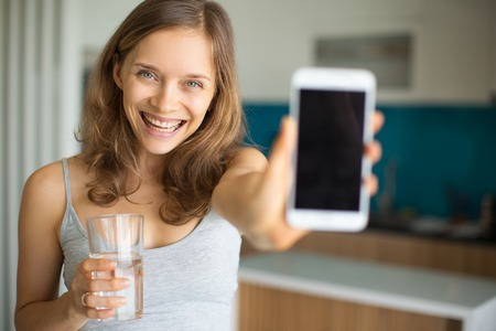 Joyful Girl Showing Smartphone Screen