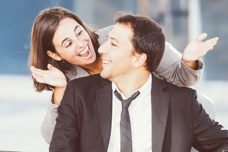 Playful Business Woman Uncovering Colleague Eyes Stock Photo