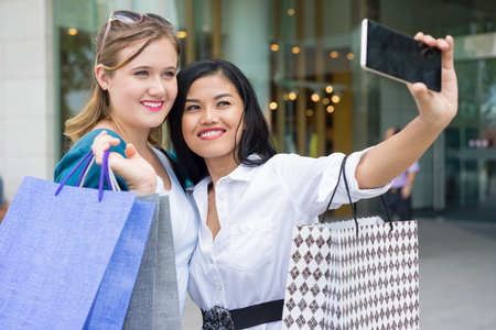 Happy Girls Shopping and Making Selfie Photo