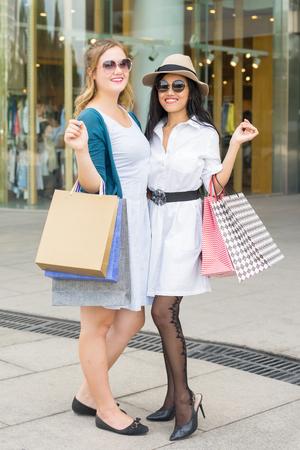 Happy Beautiful Girlfriends Shopping Outdoors