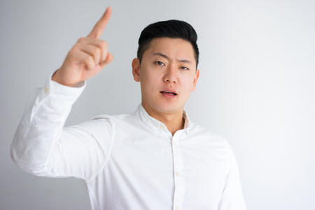 Angry Young Asian Man Scolding Someone Stock Photo