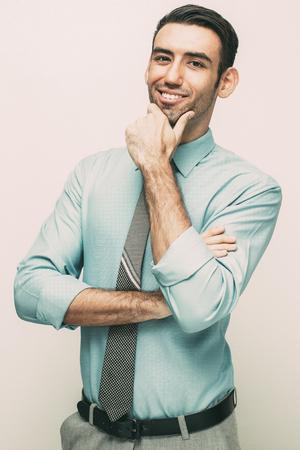 Smiling Confident Business Man Touching Chin Reklamní fotografie