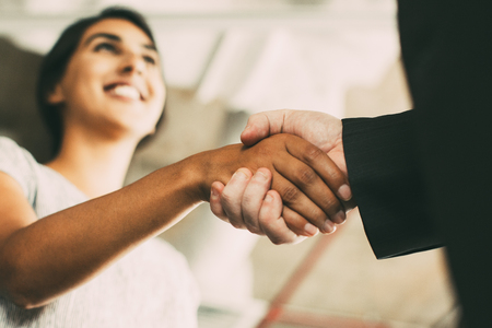 Closeup of Business Woman Shaking Partner Hand