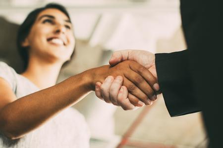 Closeup of Business Woman Shaking Partner Hand
