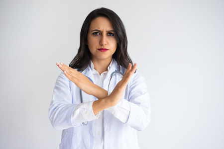Strict Female Doctor Showing Crossed Hands
