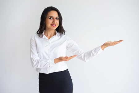 Woman Holding and Pointing at Empty Space on Palm Stock Photo