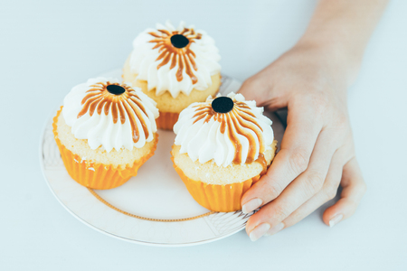 Decorated cupcakes on small plate Stock Photo
