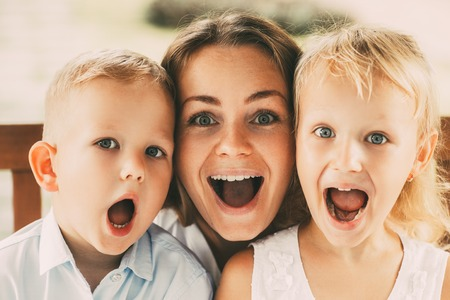 Funny Mother and Children Posing to Camera Stock Photo
