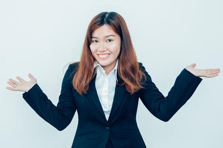 Smiling Asian Business Woman Shrugging