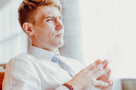 Closeup of Tensed Business Man in Office Lounge