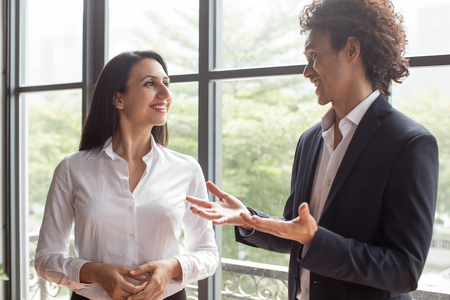 Cheerful team discussing business plan Stock Photo