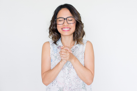 Smiling Asian Girl in Glasses Clasping Hands