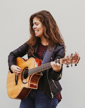 Emotional Girl Singing and Playing Guitar Archivio Fotografico