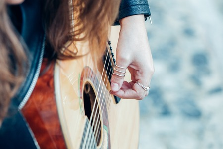 Closeup Picture of Young Woman Playing Guitar