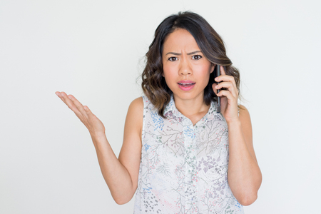 Angry Young Asian Lady Talking on Phone