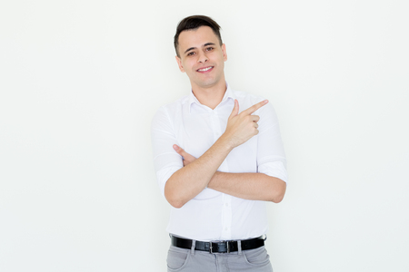 Confident Handsome Young Man Pointing Aside Stock Photo
