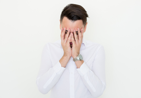 Young Business Man Covering Face with Hands