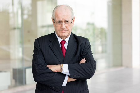 Portrait of Unhappy Senior Ceo Near to Office Building