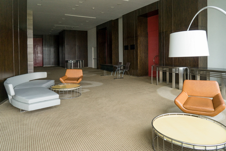 Modern Hotel Lobby With Leather Sofa And Chairs, Lamp And Round Tables.  Office Lounge