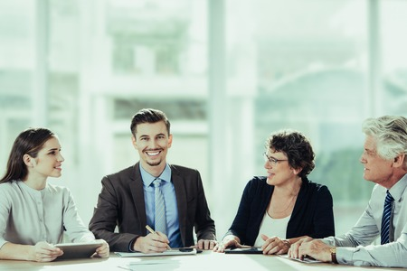 Successful young businessman smiling at camera