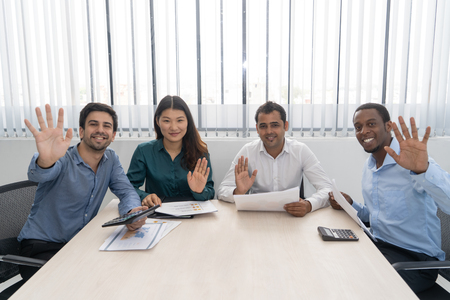 Multiracial young business team posing at meeting table