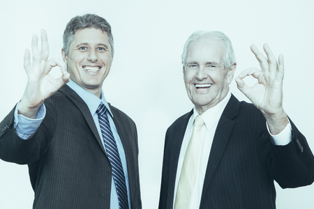Positive directors of company showing ok sign Stock Photo