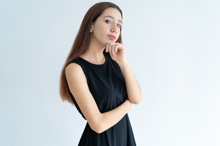Portrait of serious young Asian businesswoman standing in doubt. Arrogant beautiful woman standing with pensive expression. Snobbish woman concept