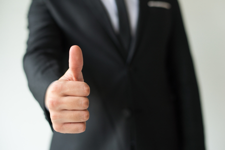 Boss gesturing good job. Closeup of businessman showing thumb up. Approval or support concept Stock Photo