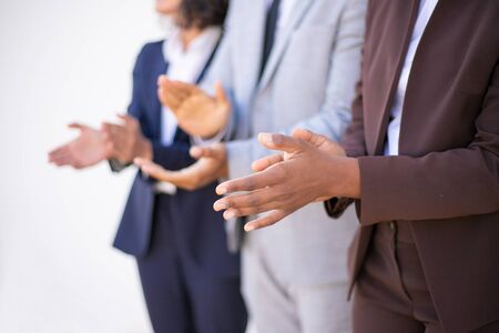 Business people clapping hands at meeting or conference. Closeup of business partners applauding to reporter. Teamwork or corporate coaching concept Stockfoto