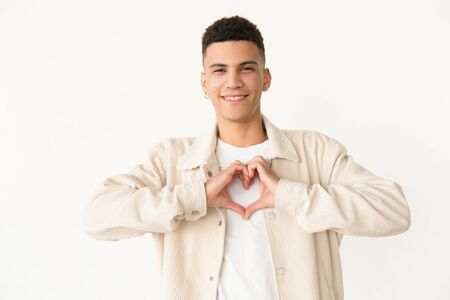 Cheerful man showing hand heart symbol. Portrait of handsome happy young man showing heart gesture with hands and smiling at camera. gesturing concept Stock Photo