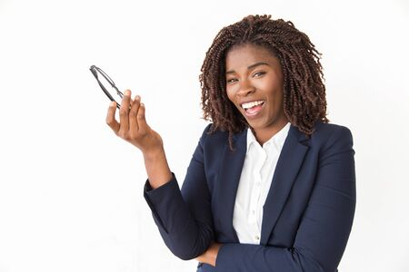 Happy joyful businesswoman holding glasses and laughing. Young African American business woman posing isolated over white background, looking at camera. Positive emotion concept