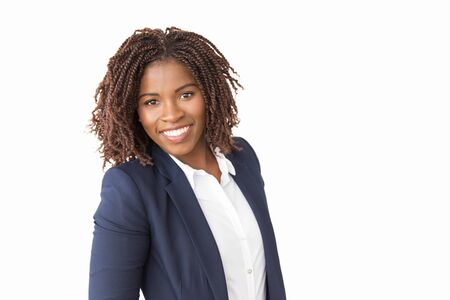 Happy successful beautiful business woman posing in studio. Young African American business lady standing isolated over white background, looking at camera, smiling. Young businesswoman concept