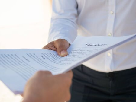 Businesswoman giving contract to partner for signing. Hands of business people holding documents. Deal or paperwork concept Фото со стока