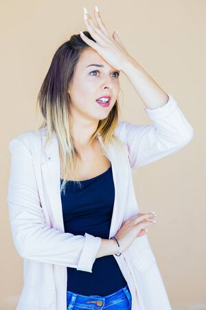 Shocked forgetful lady remembering something important. Frustrated stressed young woman slapping hand on her head and staring into vacancy. Bad memory or failure concept 版權商用圖片