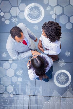 Partners near office and virtual pandemic graphics. Top view of business man and women standing outside and shaking hands. Business communication concept