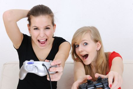 playstation: young girls playing playstation Stock Photo
