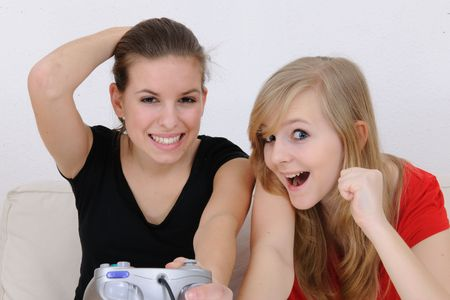 young girls playing playstation photo