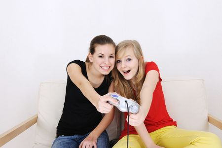 young girls playing playstation Stock Photo - 4765150
